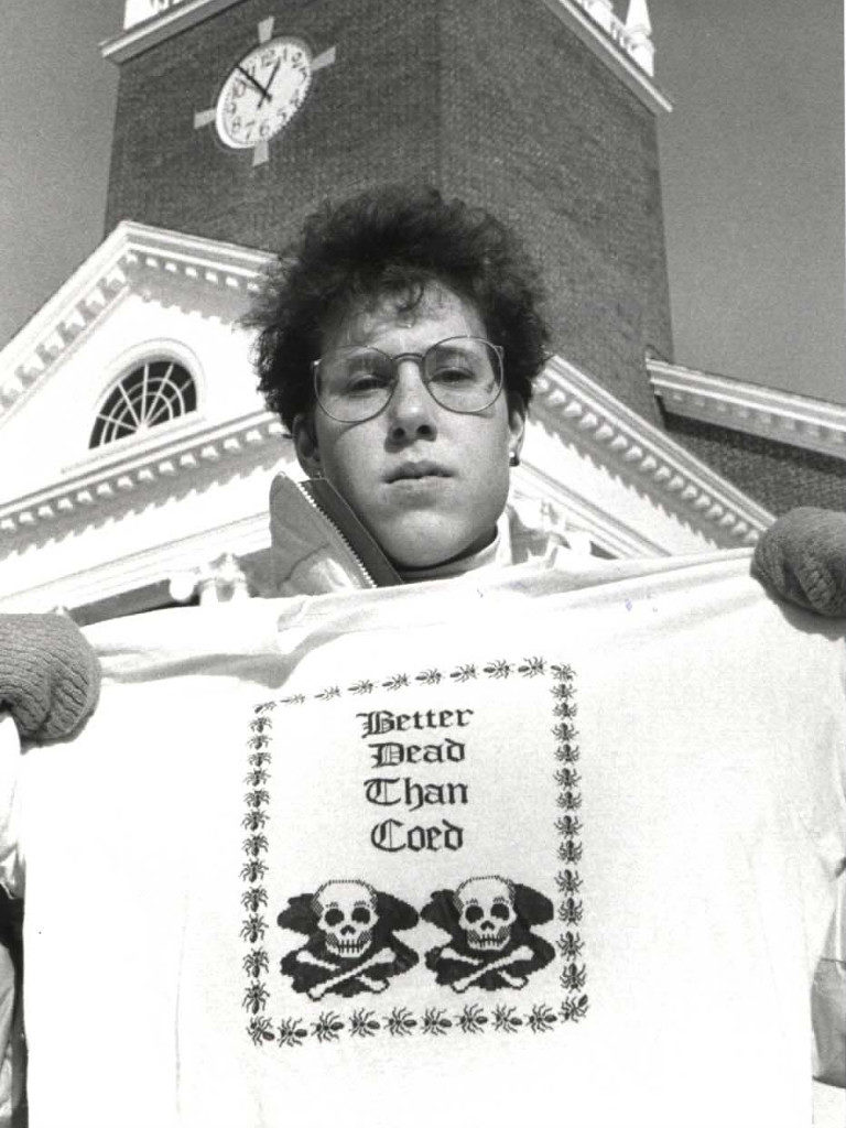 """Student Holds T-Shirt Reading, """"Better Dead Than Coed"""""""