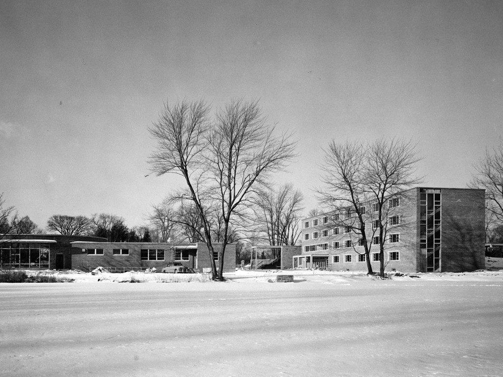 McIntire Hall across a frozen Peacock Pond