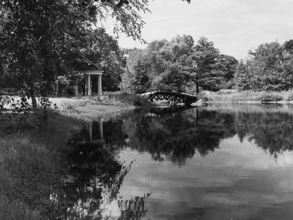 The old wooden bridge over Peacock Pond